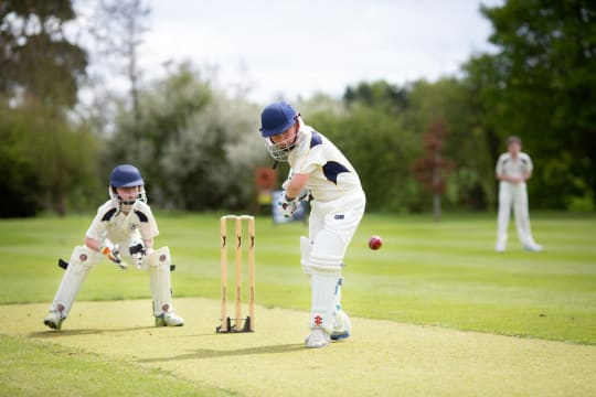 Beachborough  pupils playing cricket