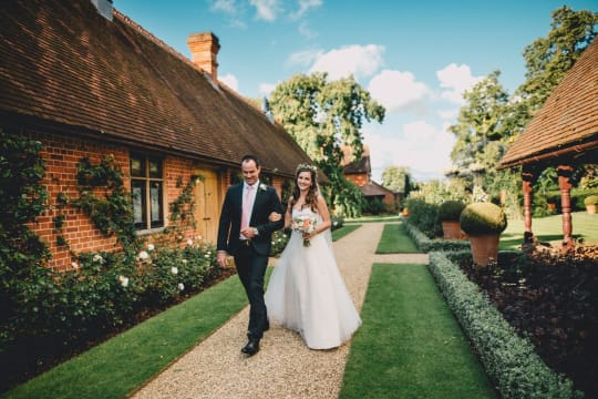 The Dairy at Waddesdon Manor Wedding Couple In Courtyard