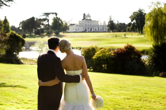 Stoke Park Wedding couple and mansion