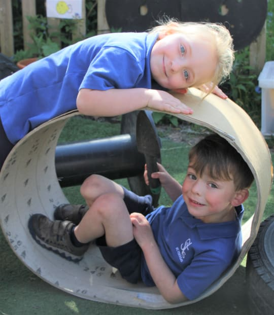 St Teresas School Reception and Pre School outdoor play in tube