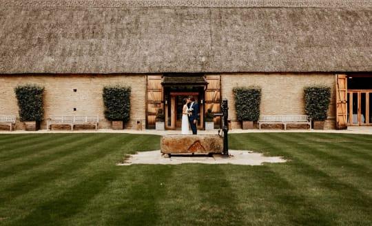 Tythe Barn Wedding Couple Outdoor ceremony