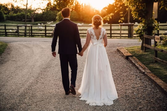 Tythe Barn Wedding Couple in Yard