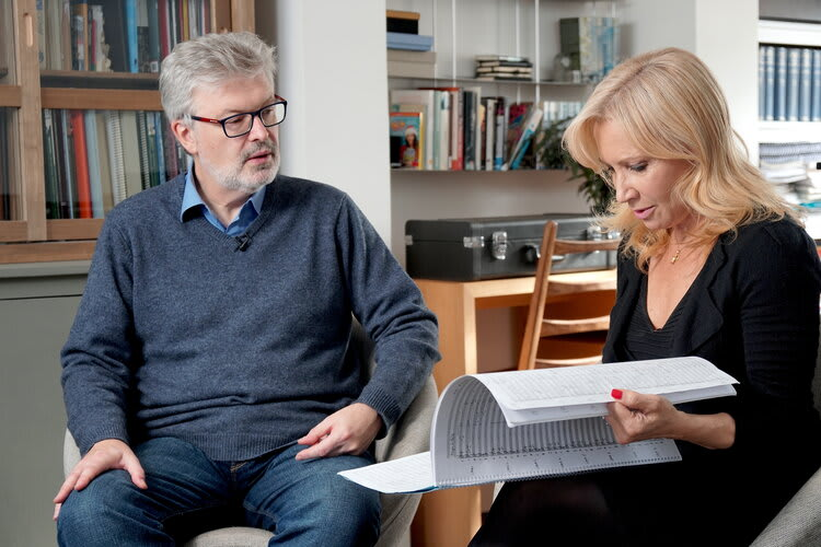 Sir James MacMillan and Suzi Digby looking over a music score fpge9e