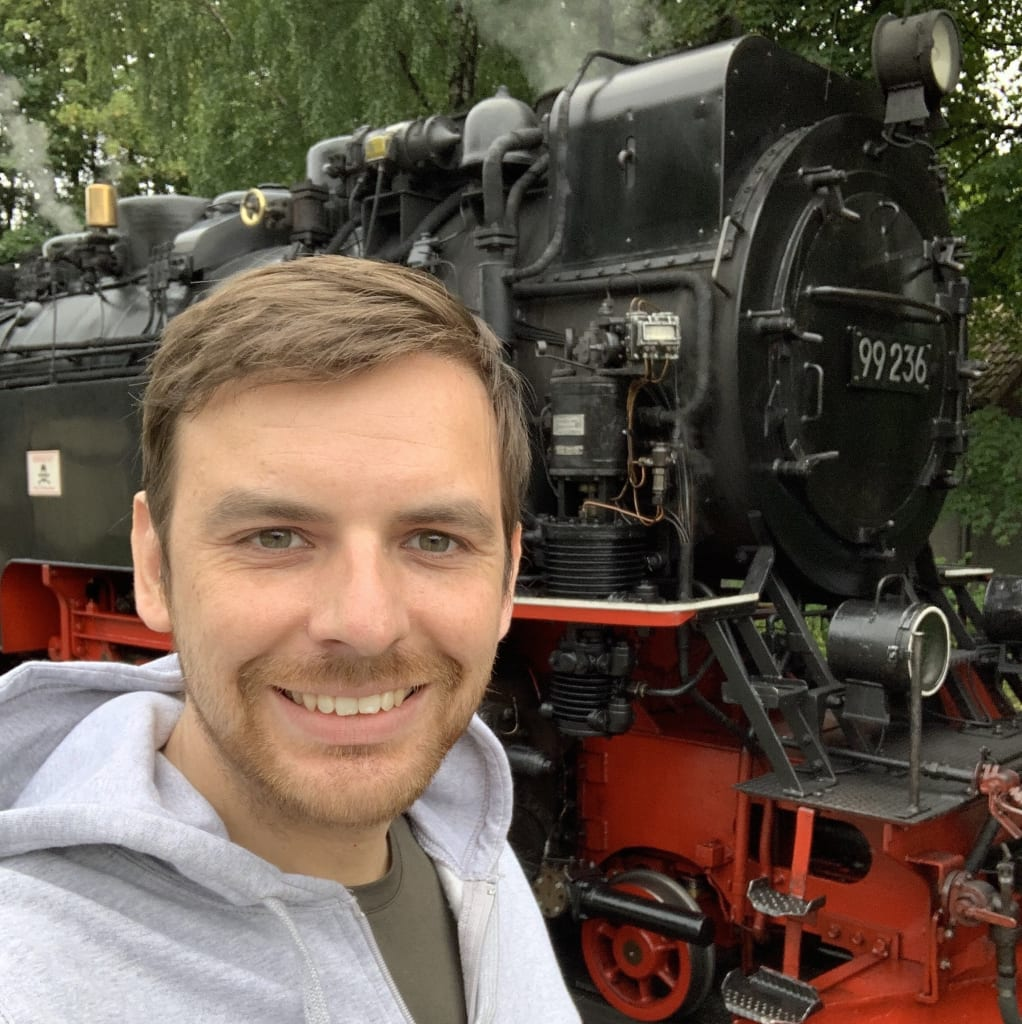 Curtis in front of a Harz HSB Steam Locomotive