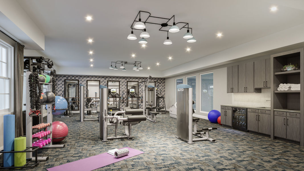 Fitness center with an array of exercise equipment at Monark Grove Clarkston in Clarkston, Michigan