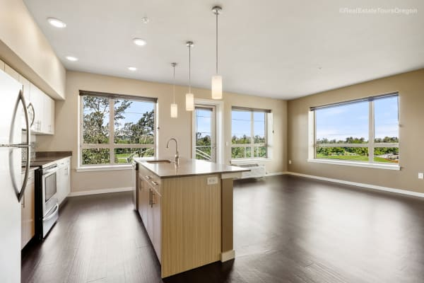 Spacious kitchen with wood flooring at South Block Apartments in Salem, Oregon