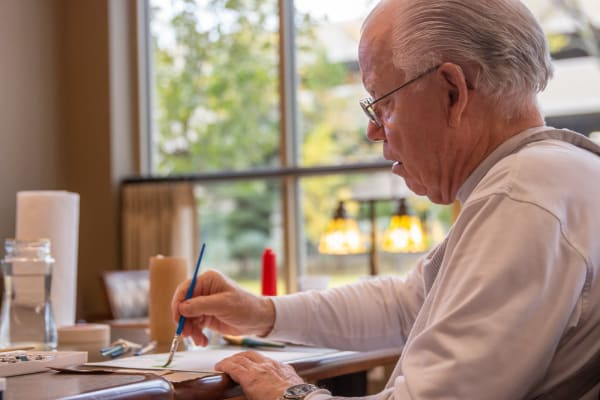 A resident painting a picture at Aurora on France in Edina, Minnesota.