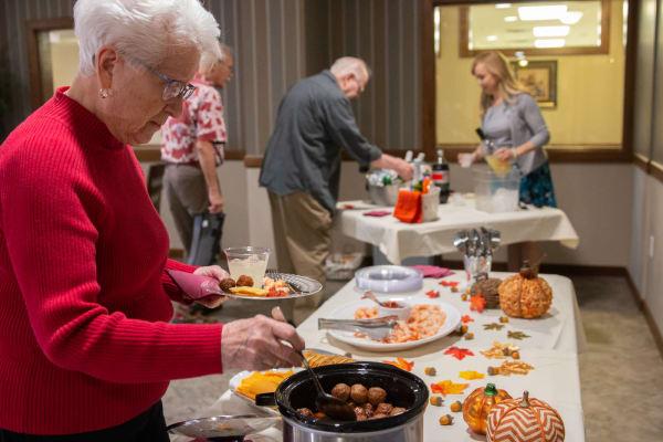 A resident enjoying a buffet at Aurora on France in Edina, Minnesota.
