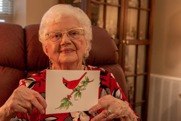 A resident holding up a card she created at Aurora on France in Edina, Minnesota.