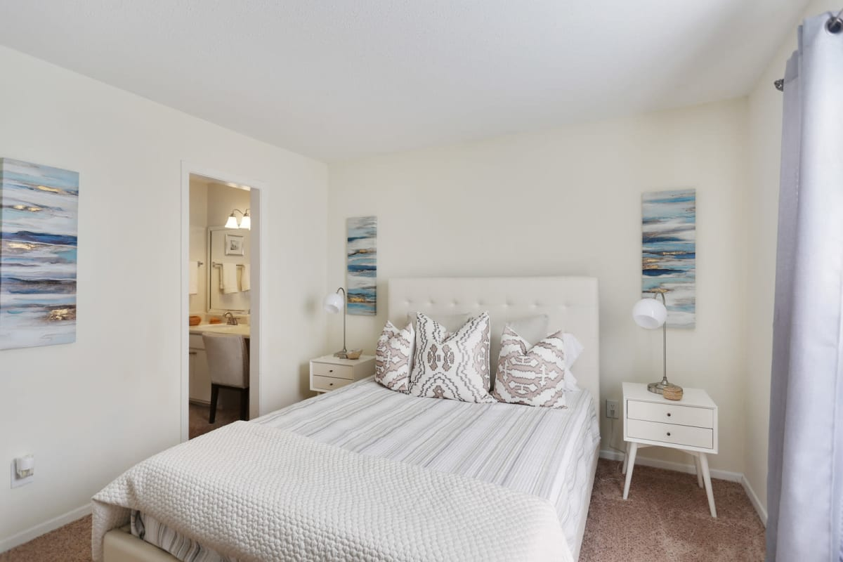 Model home's primary bedroom with an en suite bathroom at Reserve at Peachtree Corners in Norcross, Georgia