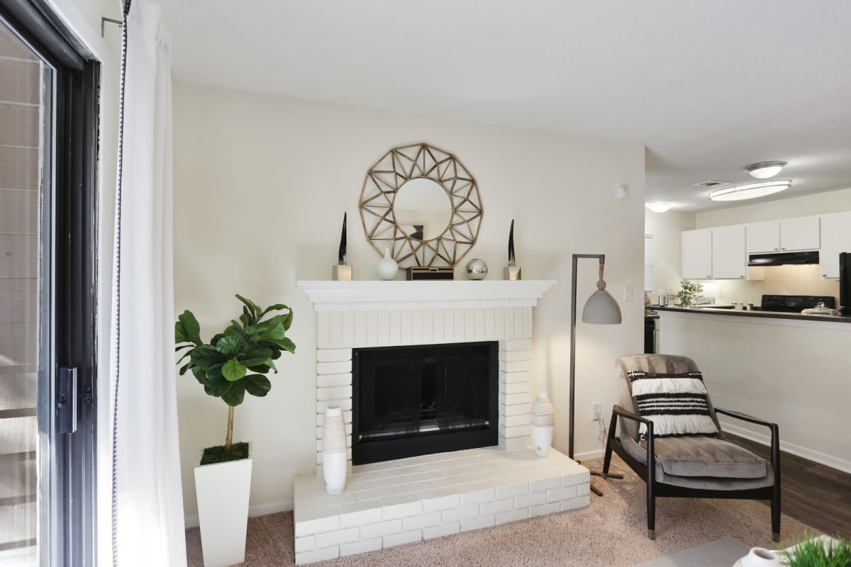 Fireplace near the kitchen in a model home at Reserve at Peachtree Corners in Norcross, Georgia