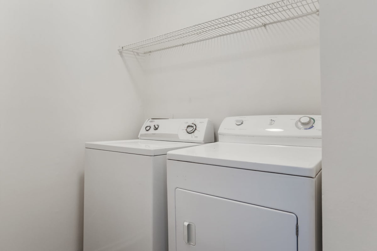 Full-size in-unit washer and dryer in a model home at Reserve at Peachtree Corners in Norcross, Georgia
