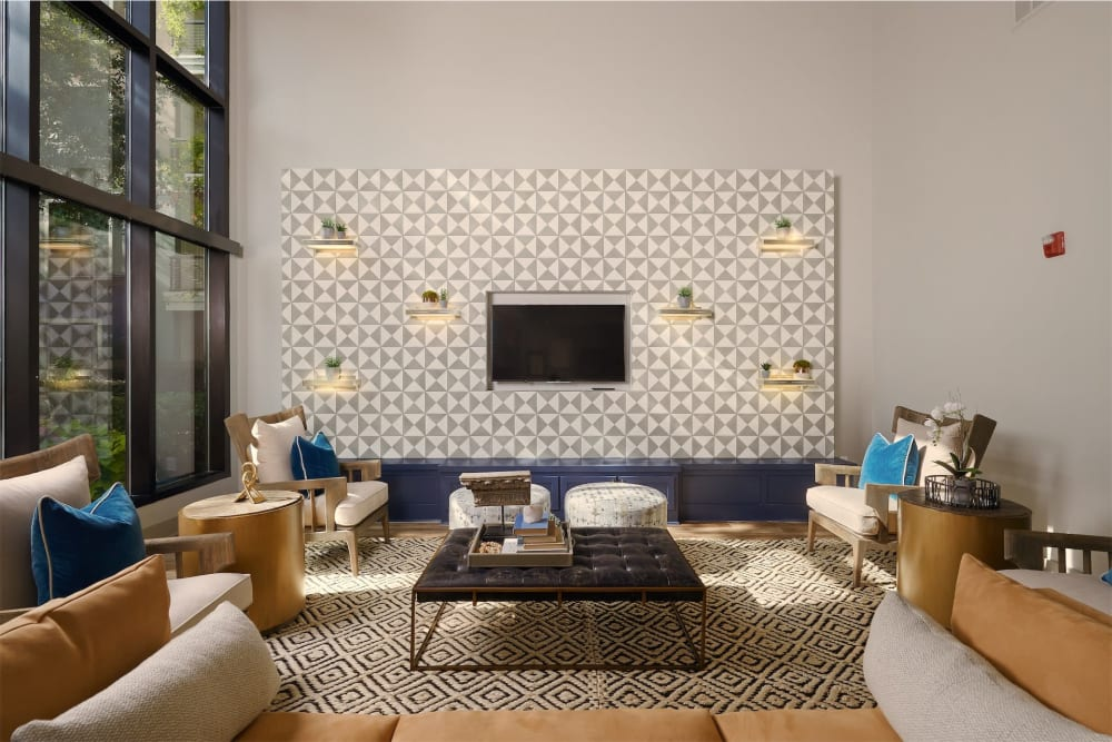 Cute living room area with tv mounted to the wall at Seville Uptown in Dallas, Texas