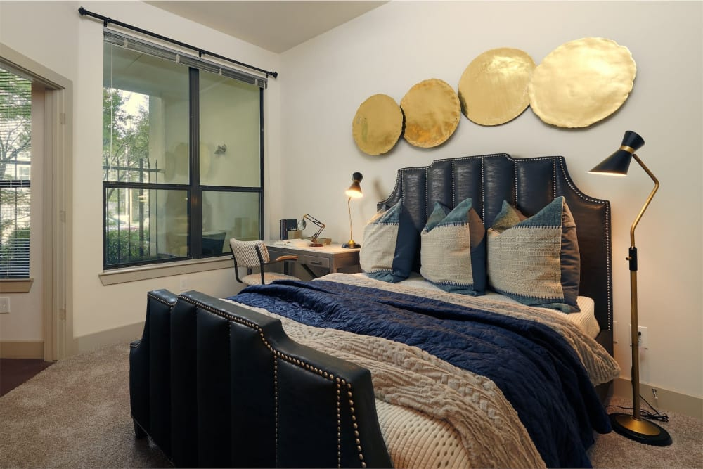 Bedroom with huge windows for tons of natural light at Seville Uptown in Dallas, Texas
