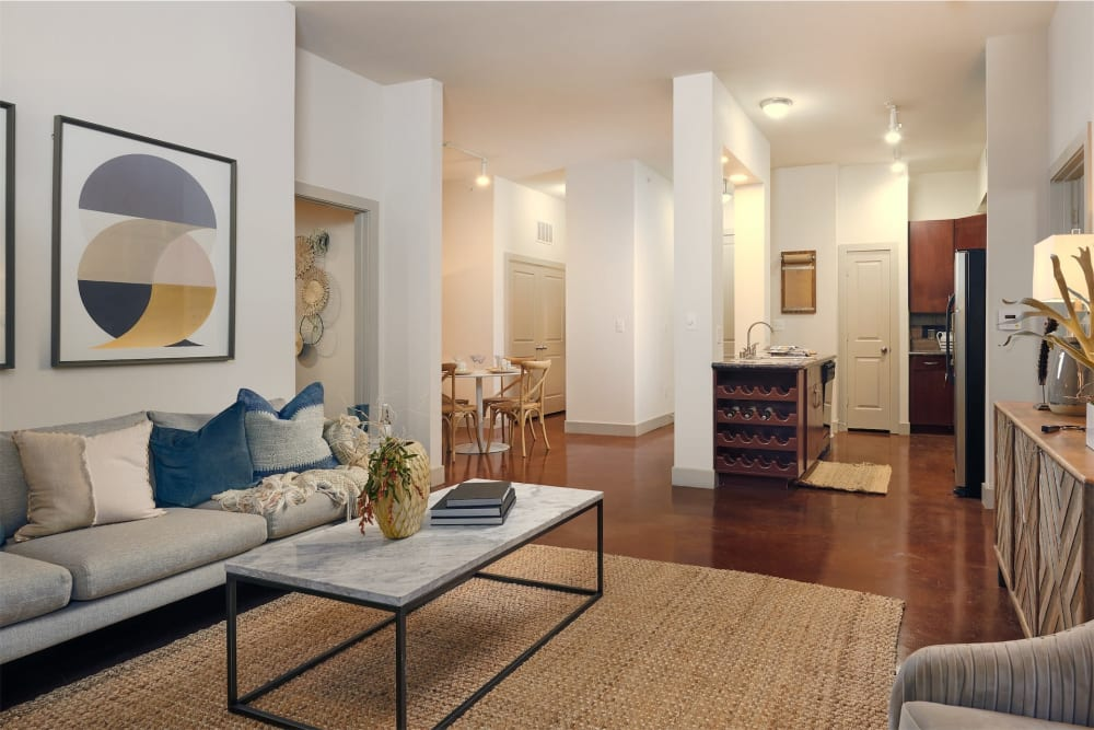 Living room with modern look and feel in model home at Seville Uptown in Dallas, Texas