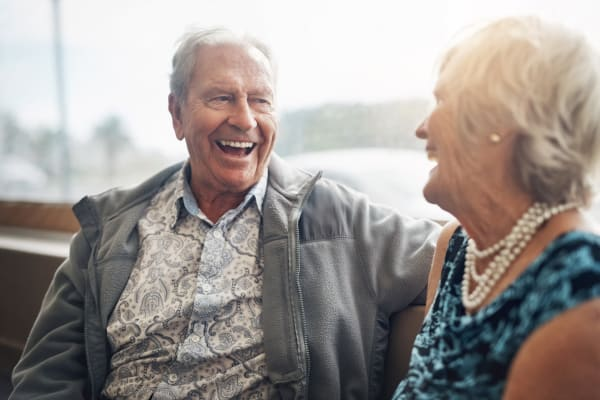 A senior couple talking at Regency Park Senior Living, Inc.