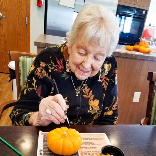 A resident filling out a questionnaire  The Oxford Grand Assisted Living & Memory Care in Wichita, Kansas
