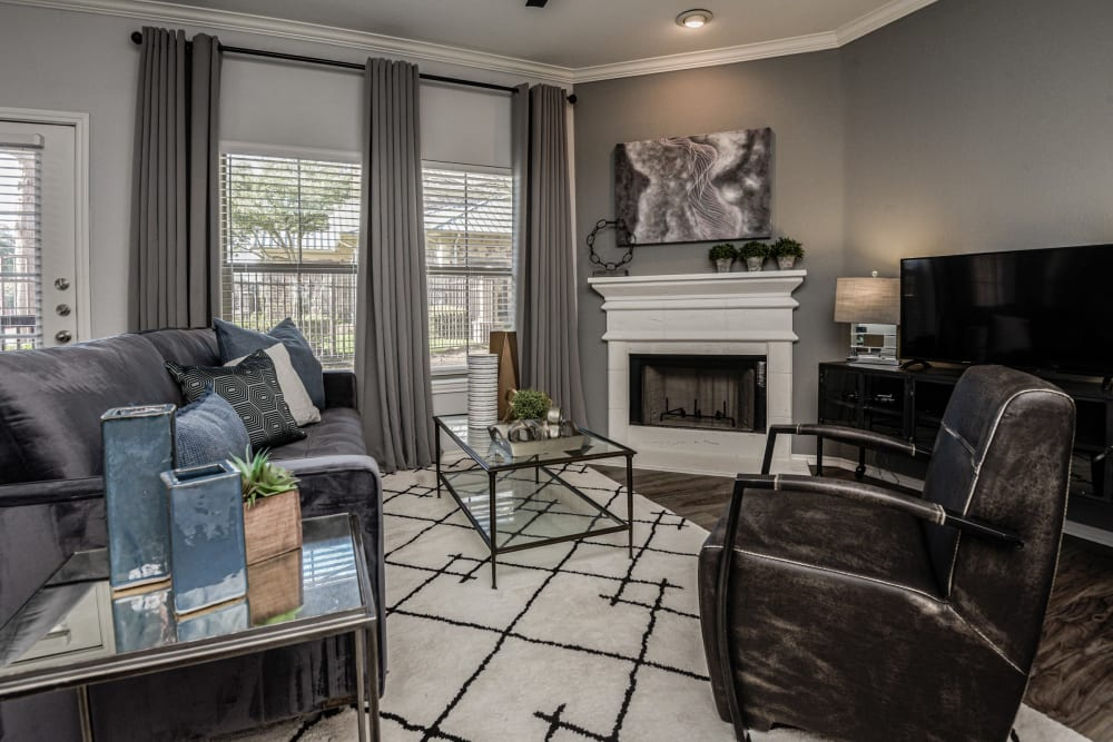 Well-decorated living room in model home at Ranch ThreeOFive in Arlington, Texas