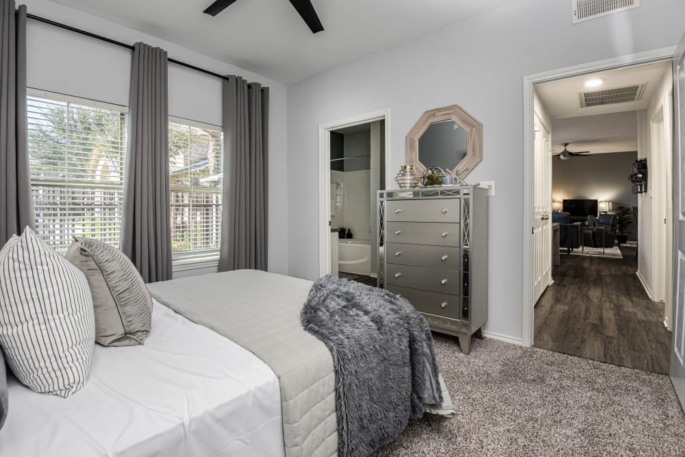 Well lit and modern decor model bedroom at Ranch ThreeOFive in Arlington, Texas