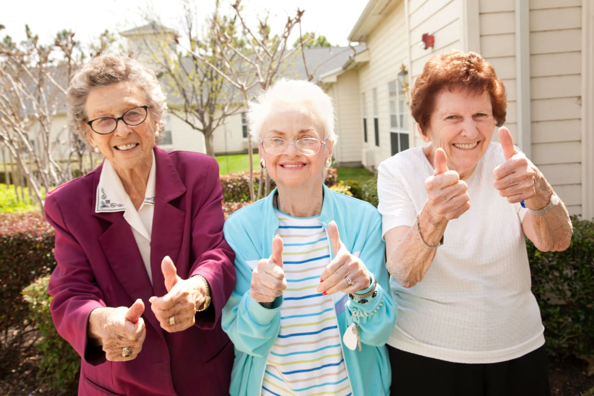 3 Residents Giving the thumbs up outside of Beach House Assisted Living & Memory Care Naples in Naples, Florida