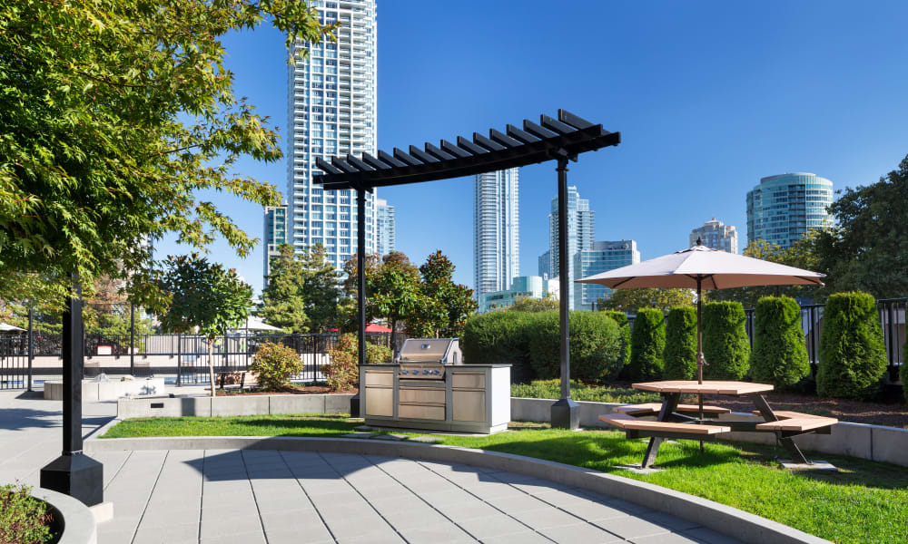 Grilling station and outdoor seating at Panarama Tower in Burnaby, British Columbia