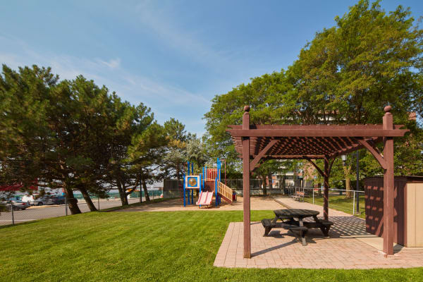Playground with covered picnic table at Richmond Hill Apartments in Richmond Hill, Ontario