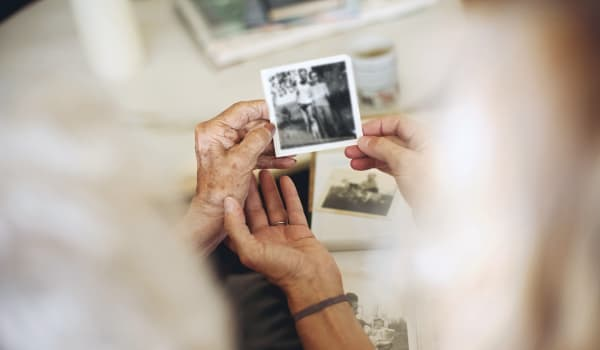 Resident reminiscing over an old photo at Anthology Senior Living in Denver, Colorado