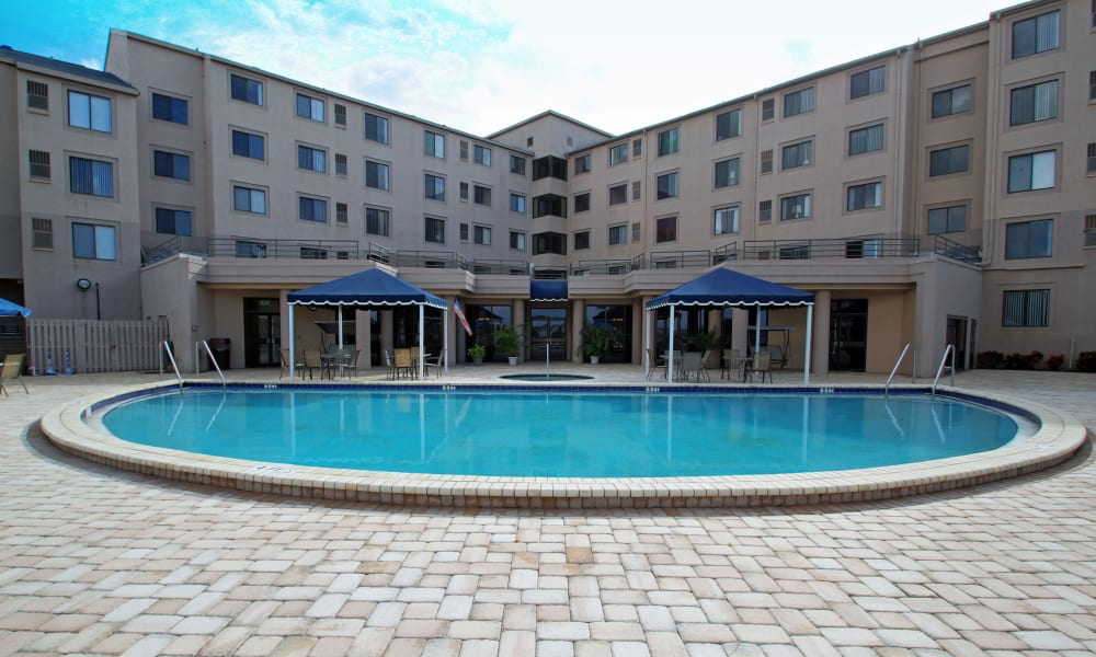 A view of the building and sparkling pool at Spring Haven in Winter Haven, Florida