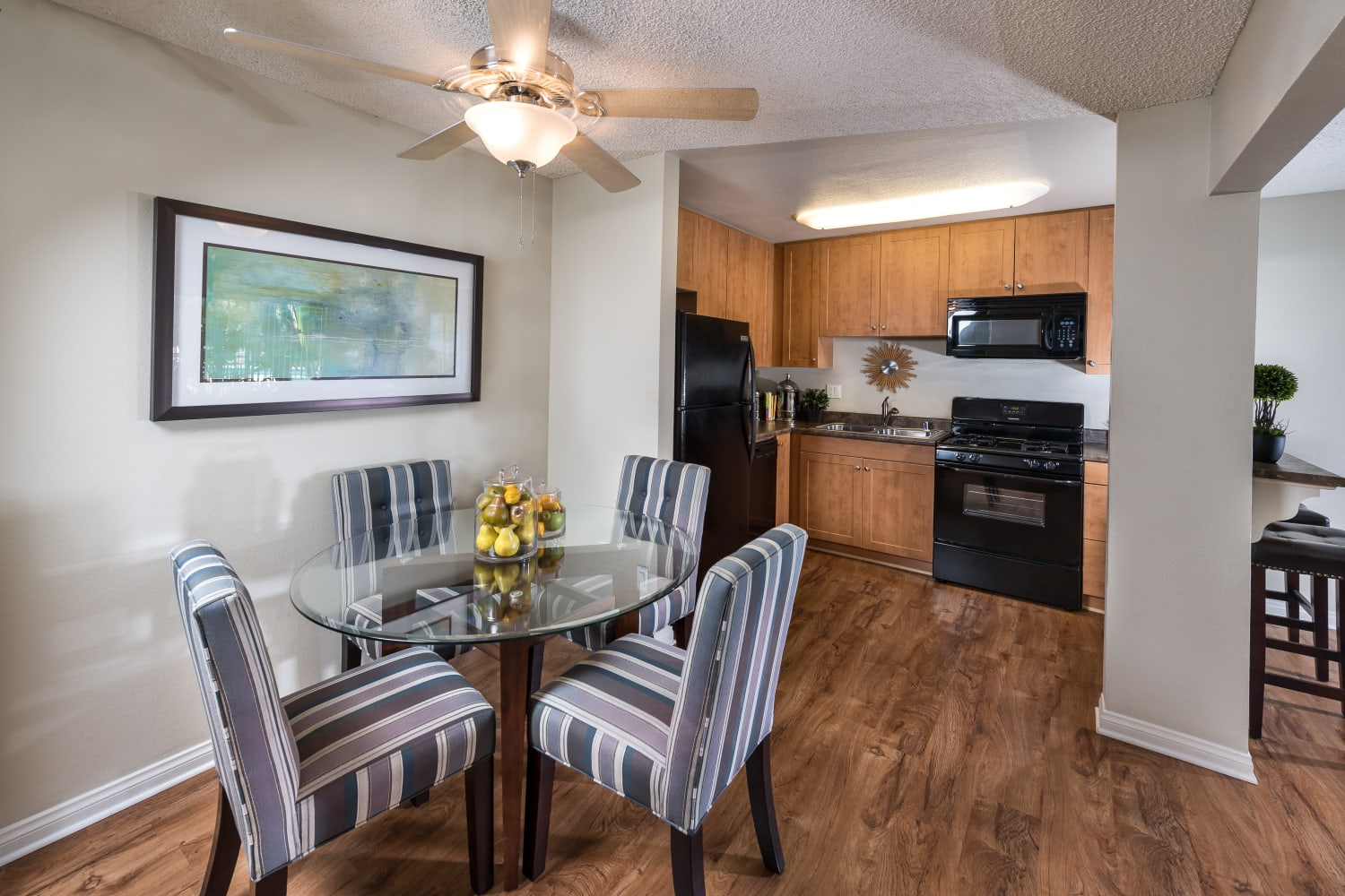 Spacious dining rooms at UCE Apartment Homes in Fullerton, California, complete with hardwood floors
