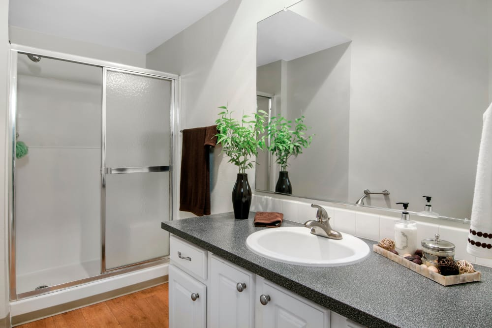 Bathroom with a large mirror and ample counter space at Autumn Chase Apartments in Vancouver, Washington