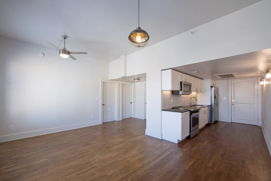Spacious apartment interior with hardwood flooring at Maverick Apartments in San Antonio, Texas