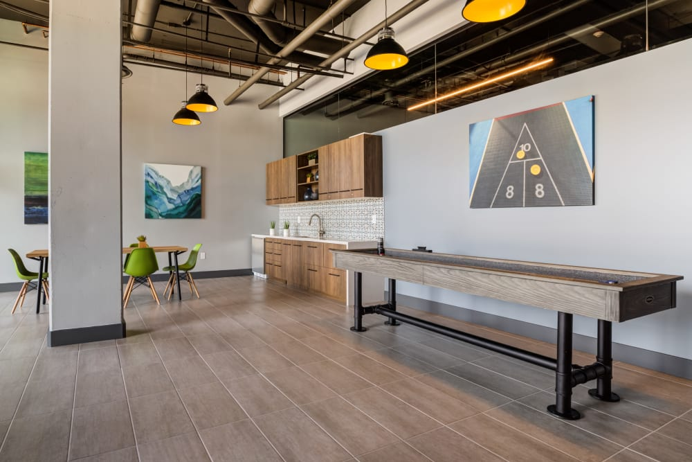 Resident clubhouse with shuffleboard table at Lumen Apartments in Everett, Washington