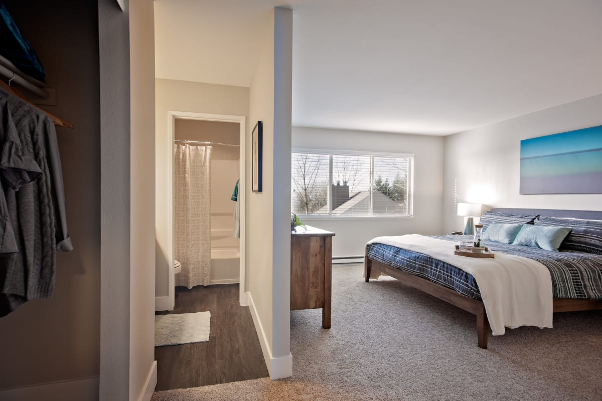 Zoomed out view of bedroom at MiLO at Mountain Park showcasing adjacent bathroom and large closet