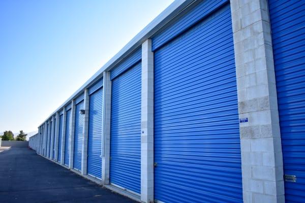Blue doors on large exterior storage units at STOR-N-LOCK Self Storage in Cottonwood Heights, Utah