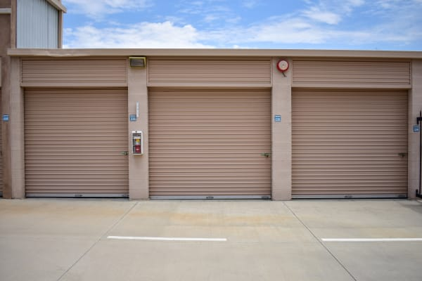 Three exterior storage units side by side at STOR-N-LOCK Self Storage in Palm Desert, California