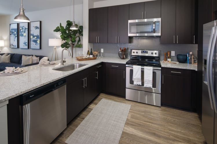 Fully-equipped kitchen at Leigh House Apartment Homes in Raleigh, North Carolina