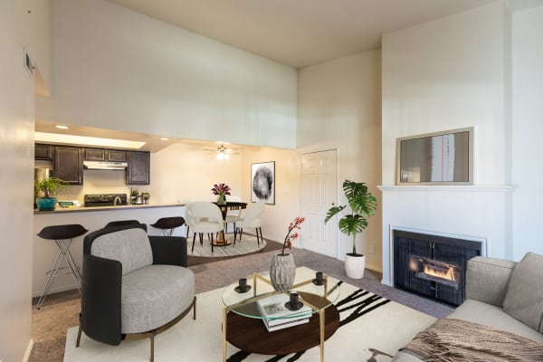 Kitchen and living room with Fireplace at Shadowbrook Apartments in West Valley City, UT