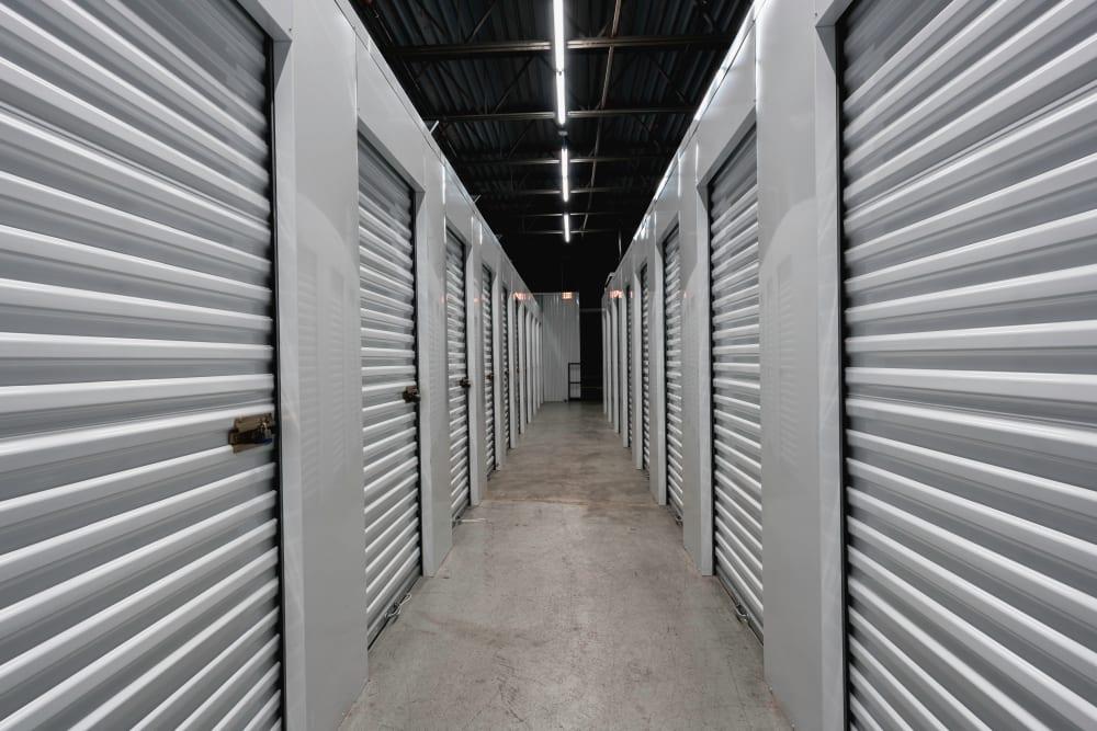 A hallway of heated storage units at Cornelius Pass Mini Storage in Hillsboro, Oregon