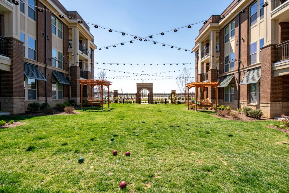 Courtyard with hanging lights at The Sawyer at One Bellevue Place in Nashville, Tennessee