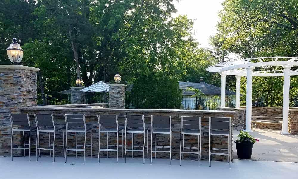 Outdoor fireside lounge and kitchen at Hunter's Chase Apartments in Westlake