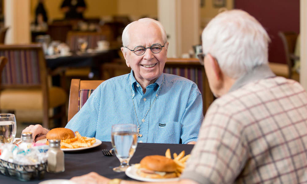 Two residents eating together at Touchmark at Harwood Groves in Fargo, North Dakota