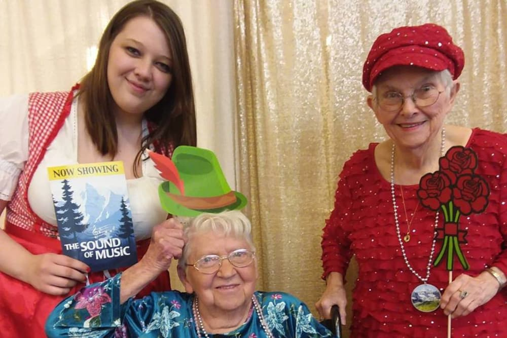 Two residents and a caretaker with props at Orchard Pointe Health Campus in Kendallville, Indiana