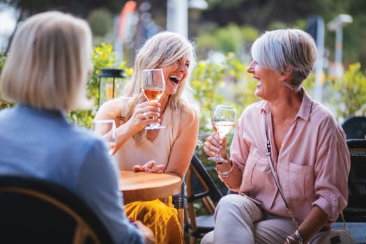 Residents enjoying a glass of wine at The Alexander in Bend, Oregon