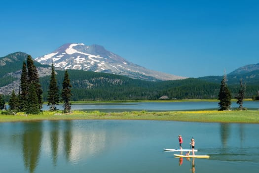 Residents paddle boarding near The Alexander in Bend, Oregon