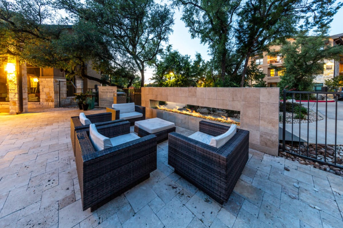 Outdoor lounge with enclosed fire pit at Marquis at Barton Trails in Austin, Texas