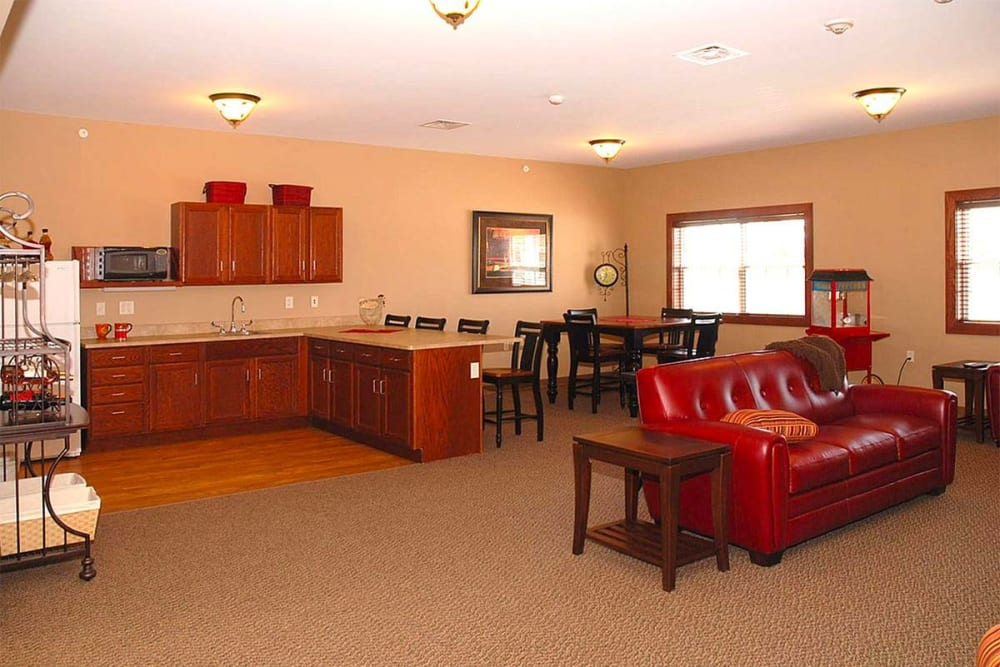 Resident activity room with kitchenette at Milestone Senior Living in Eau Claire, Wisconsin.