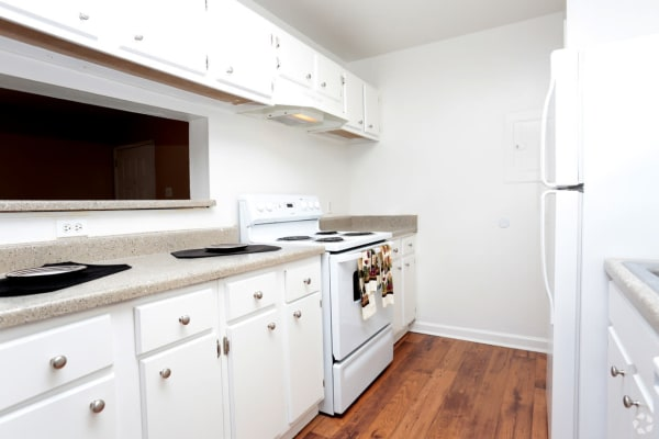 Kitchen in apartment at Woodcreek Apartments in Huntsville, Texas