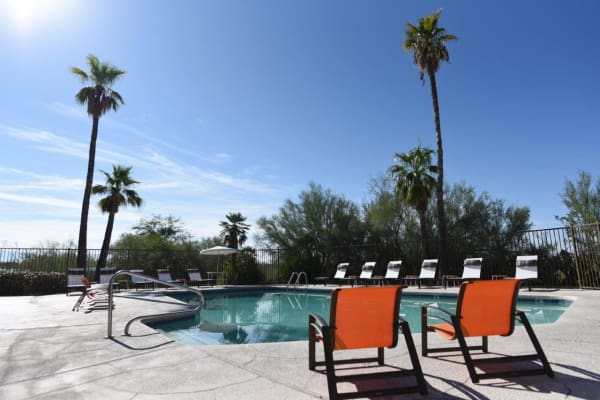 Swimming pool with chairs at Elevation Apartments in Tucson, Arizona