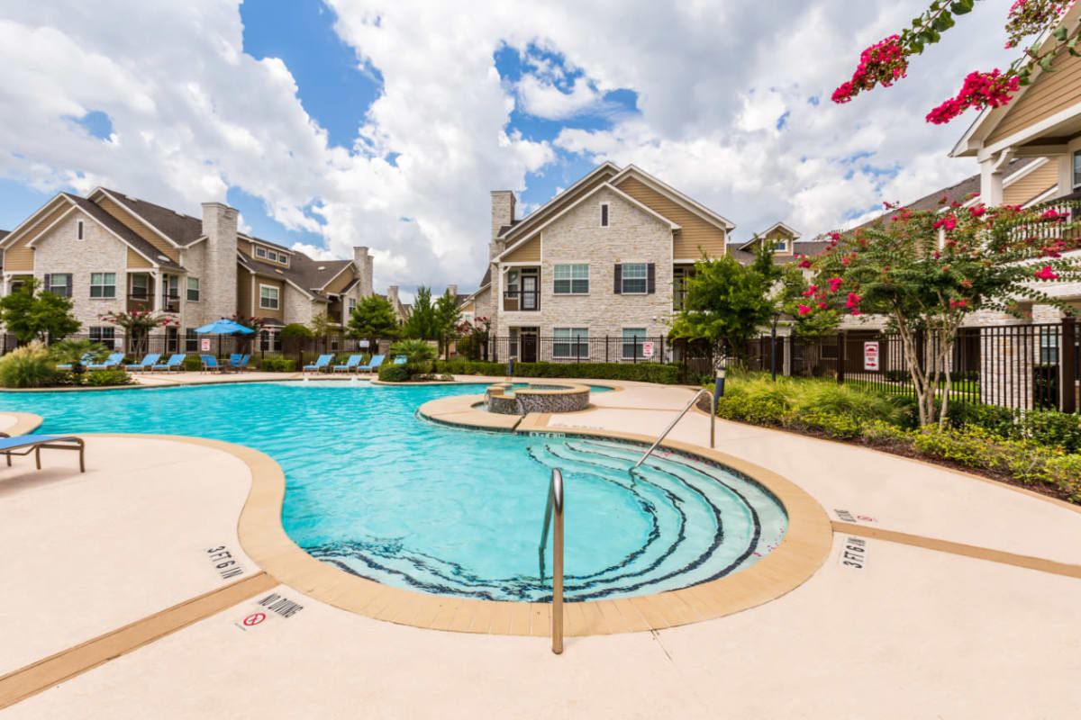 Resort-style swimming pool at Marquis at Cinco Ranch in Katy, Texas