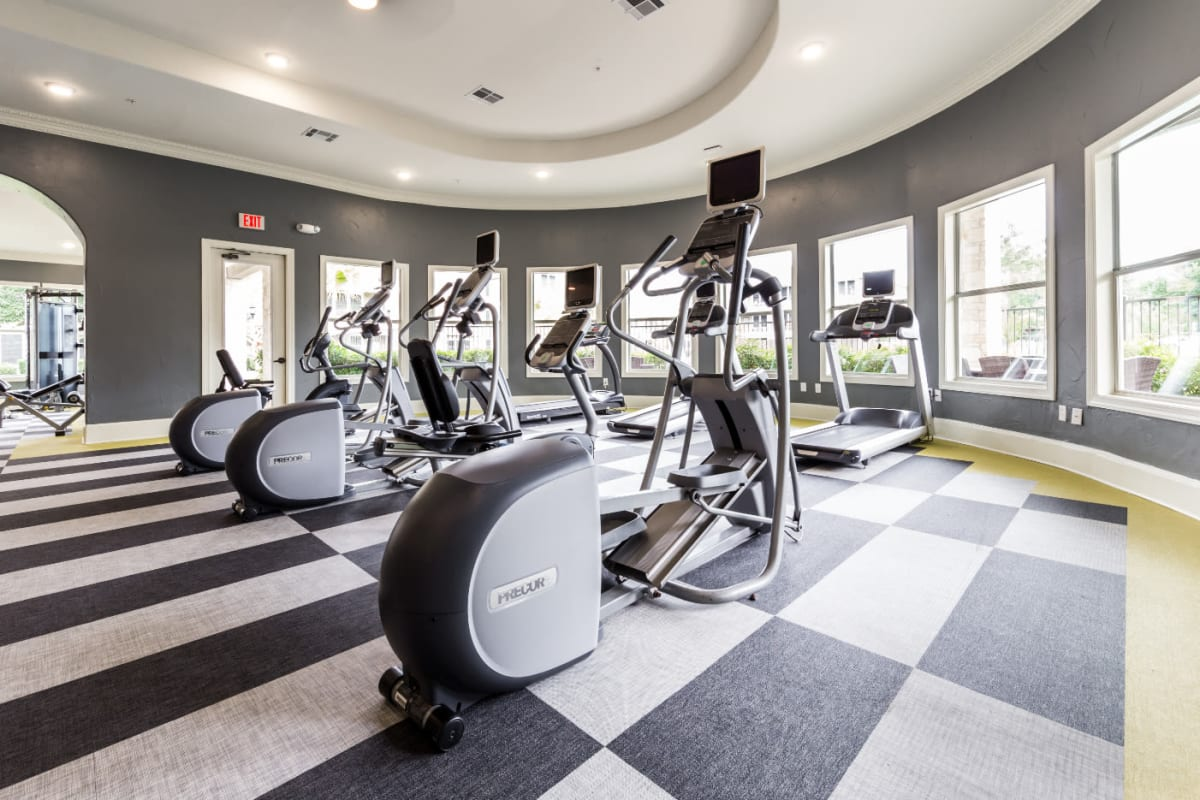 Elliptical machines and treadmills in fitness room at Marquis at The Cascades in Tyler, Texas